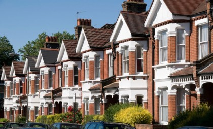Row of terraced Victorian red brick house with white painted sections